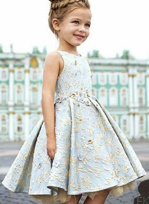 flower girl with light green floral dress