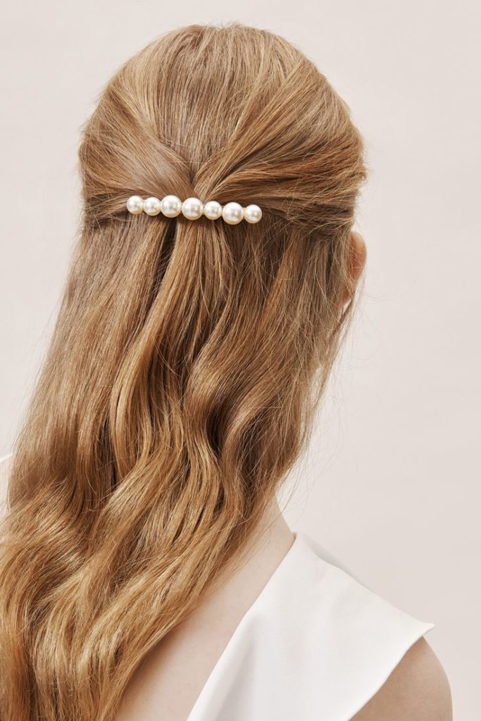 bride with long hair wearing a elegant pearl barrette