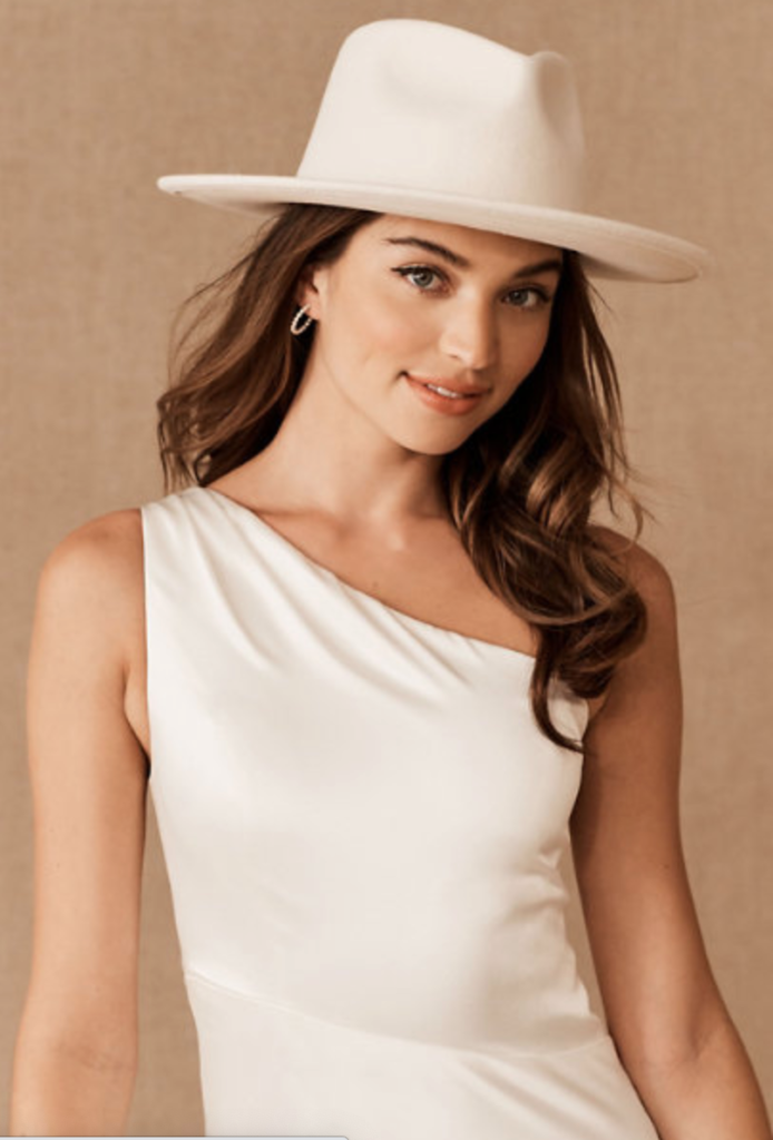 Bride wearing a ivory hat