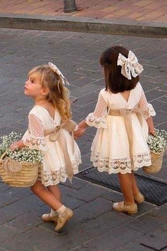 TWO GIRLS WITH FLOWER GIRL BASKETS