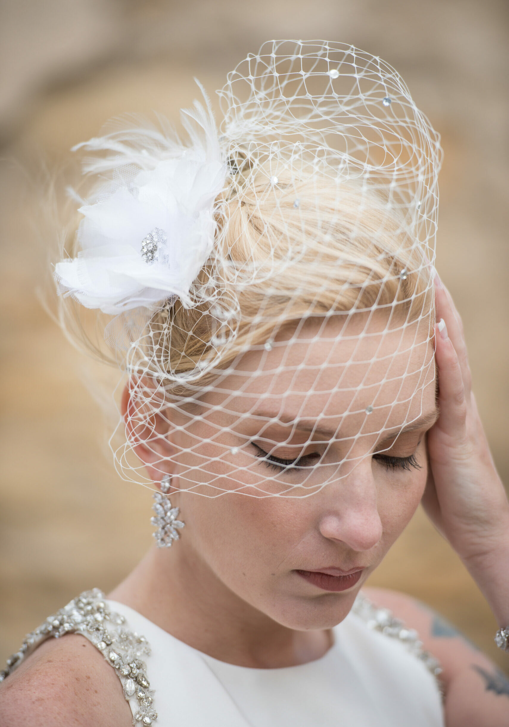 birdcage veil with flower fascinator